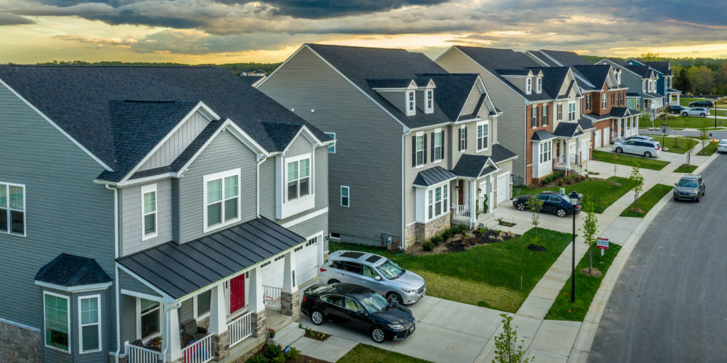Aerial view of typical American new construction neighborhood street in Maryland for the upper middle class, single family homes USA real estate with dramatic sky
